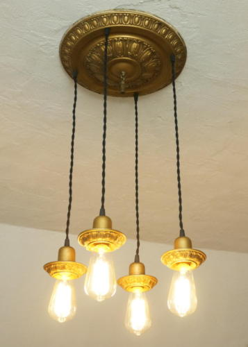 Vintage ceiling fixture repaired and Edison bulbs lowered with vintage cloth wire
